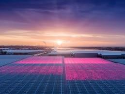 luchtfoto met glazen kassen in het Westland met roze led verlichting